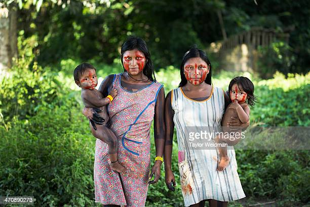 Nhakri and Nhgreiproti Xikrin women in the village of PotiKro stand for a portrait under the fruit trees behind their houses The indigenous Xikrin...