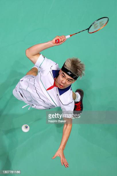Nhat Nguyen of Ireland returns a shot during his round of 16 match against Mark Caljouw of The Netherlands during day two of YONEX All England Open...