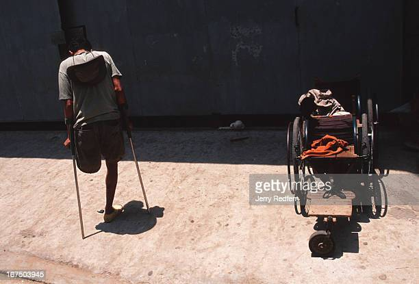 Nhat Pon wobbles his way into the shade of Wat Ounalom He lost his leg while a soldier and now makes a poor living as a beggar He tries to make...