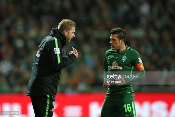 'nHead coach 'nFlorian Kohfeldt of Werder Bremen 'nspeak with 'nZlatko Junuzovic of Werder Bremen 'nduring the Bundesliga match between SV Werder...