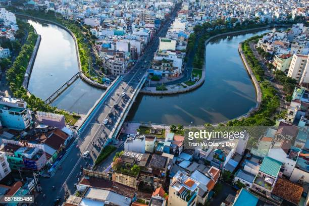 nhieu loc channel in the sunshine. - people's committee building ho chi minh city stock pictures, royalty-free photos & images