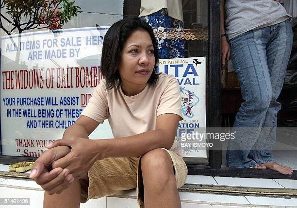 Ni Luh Erniati whose husband was killed in the Bali bomb attacks sits in front of her store in Kuta Bali 11 October 2004 Indonesia on Tuesday marks...