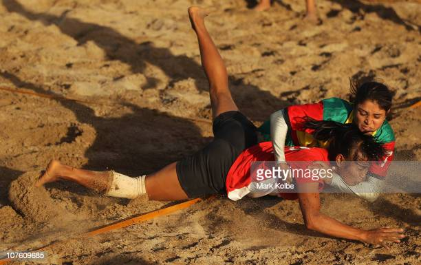 Ni Luh Putu Rissatya of Indonesia is tackled by the Bangladesh defence as she competes in the Beach Kabaddi event at North Al Hail during day eight...