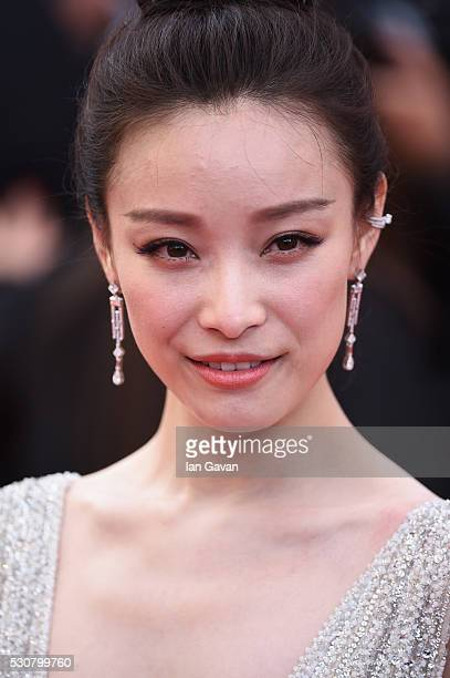 Ni Ni attends the 'Cafe Society' premiere and the Opening Night Gala during the 69th annual Cannes Film Festival at the Palais des Festivals on May...
