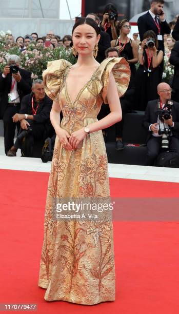 Ni Ni walks the red carpet ahead of the opening ceremony during the 76th Venice Film Festival at Sala Casino on August 28 2019 in Venice Italy
