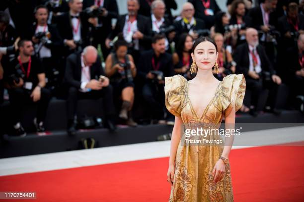 Ni Ni wearing a JaegerLeCoultre watch walks the red carpet ahead of the Opening Ceremony and the La Vérité screening during the 76th Venice Film...