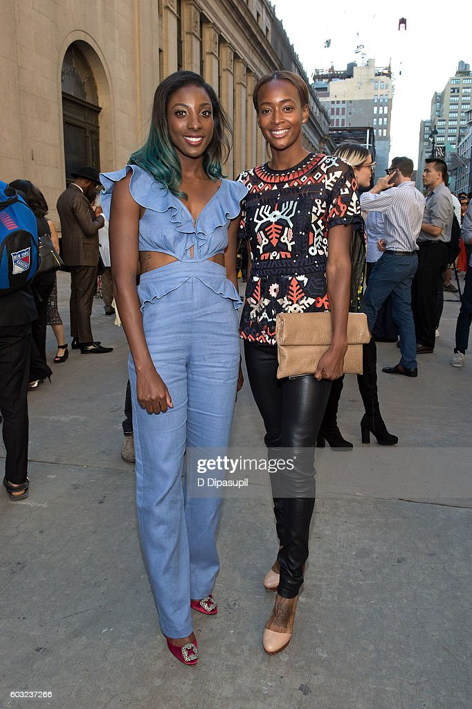 Nia Ali (L) and Dalilah Muhammad pose during New York Fashion Week: The Shows at Skylight at Moynihan Station on September 12, 2016 in New York City.