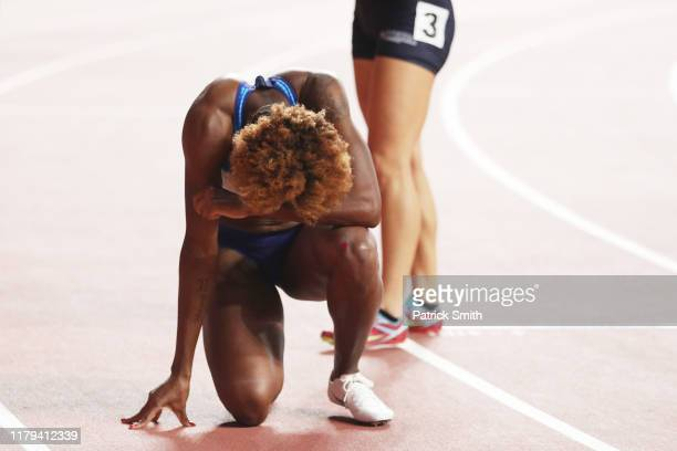 Nia Ali of the United States celebrates winning gold in the Women's 100 metres hurdles final during day ten of 17th IAAF World Athletics...