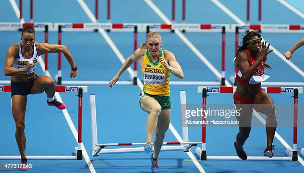 Nia Ali of the United States wins the gold medal with silver medalist Sally Pearson of Australia and Cindy Billaud of France in the Women's 60m...