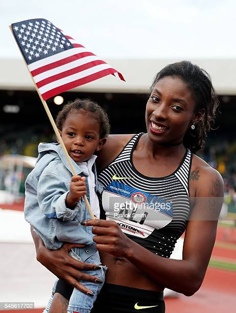 Nia Ali third place celebrates with son Titus after the Women's 100 Meter Hurdles Final during the 2016 US Olympic Track Field Team Trials at Hayward...