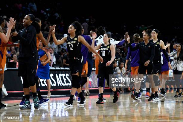 Nia Coffey and Kelsey Plum of the Las Vegas Aces highfives Phoenix Mercury team after the game on June 17 2018 at the Mandalay Bay Events Center in...