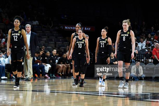 Nia Coffey Kelsey Plum Kayla McBride and Carolyn Swords of the Las Vegas Aces enter the court after a timeout against the Phoenix Mercury on June 17...