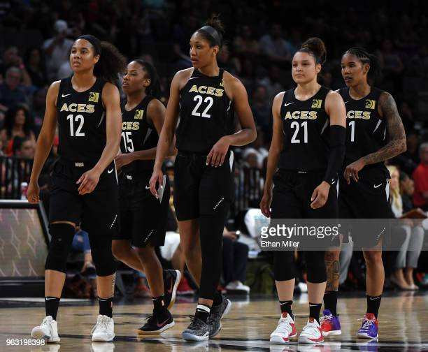 Nia Coffey Lindsay Allen A'ja Wilson Kayla McBride and Tamera Young of the Las Vegas Aces walk on the court after a timeout during the Aces'...