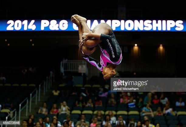 Nia Dennis competes on the balance beam in the junior women finals during the 2014 PG Gymnastics Championships at Consol Energy Center on August 23...