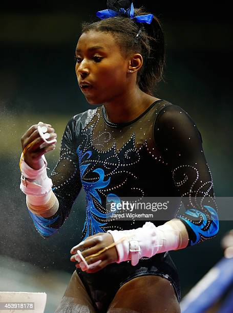 Nia Dennis competes on the bars in the junior women preliminaries during the 2014 PG Gymnastics Championships at Consol Energy Center on August 21...