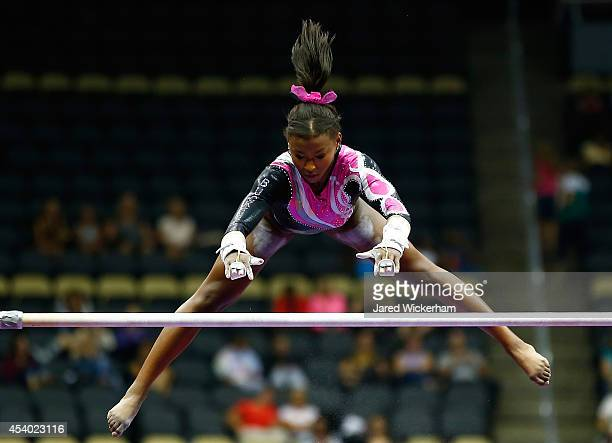 Nia Dennis competes on the uneven bars in the junior women finals during the 2014 PG Gymnastics Championships at Consol Energy Center on August 23...