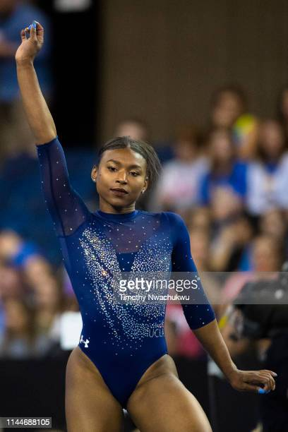 Nia Dennis of the UCLA Bruins performs a floor routine during the Division I Women's Gymnastics Championship held at the Fort Worth Convention Center...