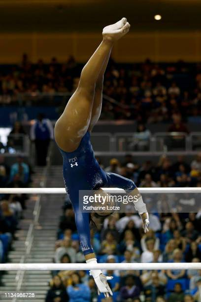Nia Dennis of UCLA competes in the uneven parallel bars during a meet against Stanford at Pauley Pavilion on March 10 2019 in Los Angeles California