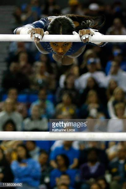 Nia Dennis of UCLA competes on the uneven parallel bars during a meet against Stanford at Pauley Pavilion on March 10 2019 in Los Angeles California