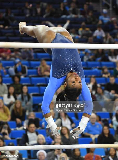 Nia Dennis on the uneven bars during UCLA Gymnastics Meet the Bruins intrasquad event at Pauley Pavilion on December 14 2019 in Los Angeles California
