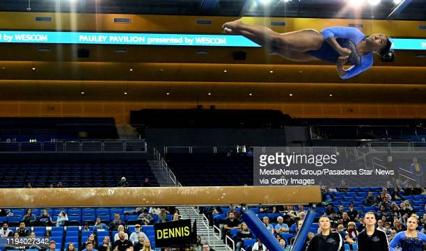 Nia Dennis performs on the balance beam during the Meet The Bruins gymnastics exhibition in Pauley Pavilion on the campus of UCLA on Saturday...