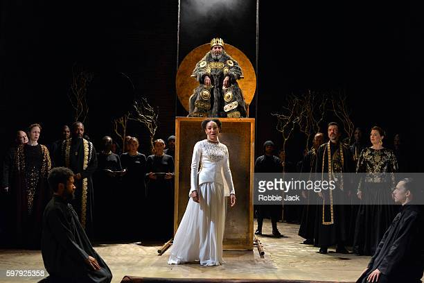 Nia Gwynne as Goneril, Natalie Simpson as Cordelia, Antony Sher as King Lear and Kelly Williams as Regan with artists of the company in William...