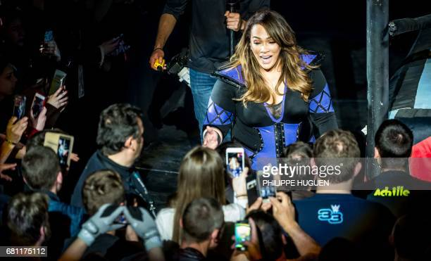 Nia Jax arrives in the ring during the WWE show at Zenith Arena on may 09 2017 in Lille north France / AFP PHOTO / PHILIPPE HUGUEN