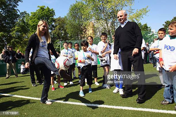 Nia Kuenzer and Bernd Hoelzenbein during the kick off for a DFB Mini Soccer Field at FriedrichFroebelSchule on May 5 2011 in Neu Isenburg Germany