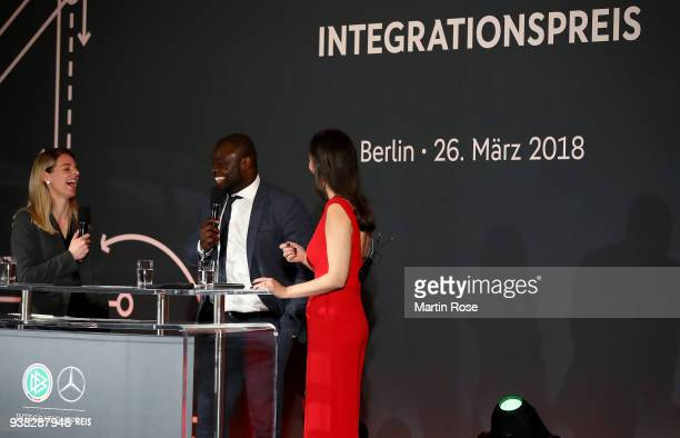 Nia Kuenzer and Gerald Asamoah speak to the audience during Integration Prize Awarding Ceremony at Axica Kongress und Tagungszentrum on March 26 2018...