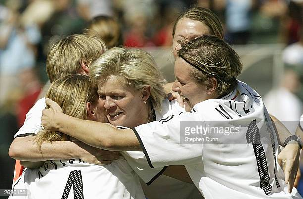 Nia Kuenzer and Martina Mueller of Germany celebrate with a teammate after defeating Sweden in the FIFA Women's World Cup Final on October 12 2003 at...
