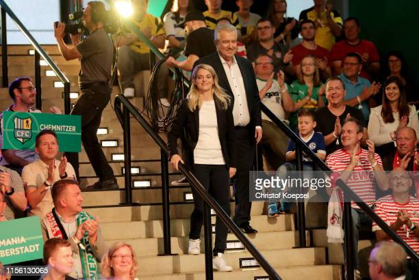 Nia Kuenzer former player of Germany and Peter Frymuth head of DFB Cup Draw and vicepresident of DFB walk down the stairs during the DFB Cup 2019/20...
