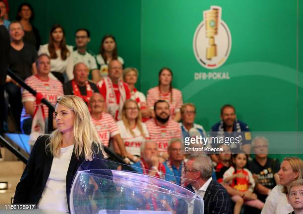 Nia Kuenzer former player of Germany draws the matches during the DFB Cup 2019/20 First Round Draw at Deutsches Fussballmuseum on June 15 2019 in...