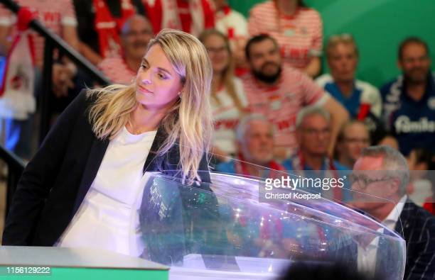 Nia Kuenzer former player of Germany drwas the matches during the DFB Cup 2019/20 First Round Draw at Deutsches Fussballmuseum on June 15 2019 in...