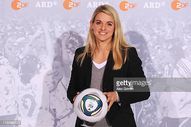 Nia Kuenzer poses during a photocall with the ARD and ZDF TV presenters for the FIFA Women World Cup 2011 at the Commerzbank Arena on March 17 2011...