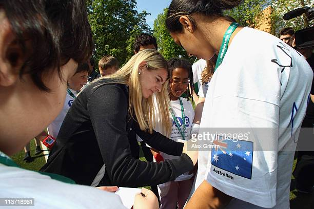 Nia Kuenzer signs autographs during the presentation of a DFB Mini Soccer Field at FriedrichFroebelSchule on May 5 2011 in Neu Isenburg Germany