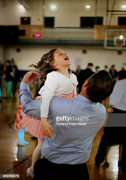 Nia laughs as she dances with her father Scott Corbett at the father/daughter dance in South Portland