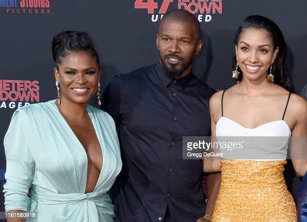 Nia Long Jamie Foxx and Corinne Foxx arrive at the LA Premiere Of Entertainment Studios' 47 Meters Down Uncaged at Regency Village Theatre on August...