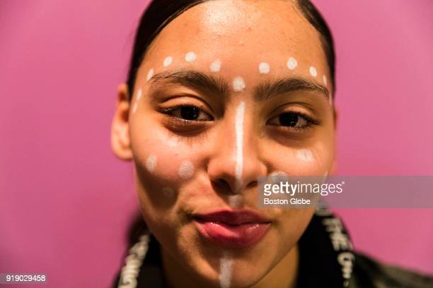 Nia Ramos a student from Boston Arts Academy wears face paint similar to characters from the Black Panther comic book series during a discussion of...