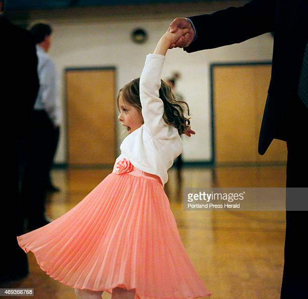 Nia spins while dancing with her father Scott Corbett at the father/daughter dance in South Portland