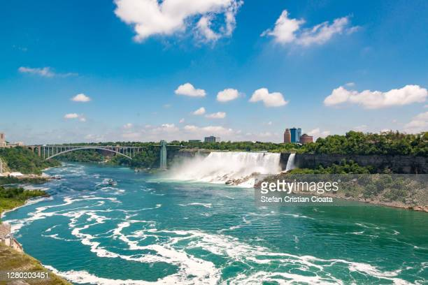 niagara falls and rainbow bridge, canada - buffalo new york state stock pictures, royalty-free photos & images