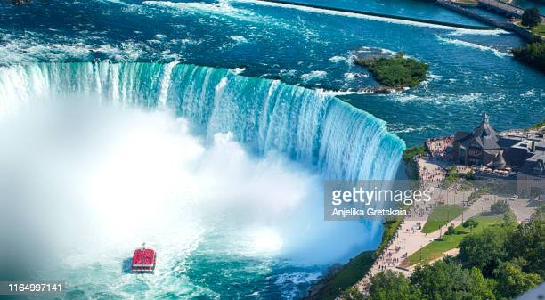 niagara falls boat tours attraction. horseshoe falls at niagara falls, ontario, canada - niagara falls stock pictures, royalty-free photos & images