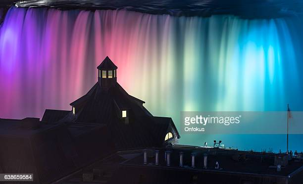 niagara falls illuminated at night - niagara falls stock pictures, royalty-free photos & images