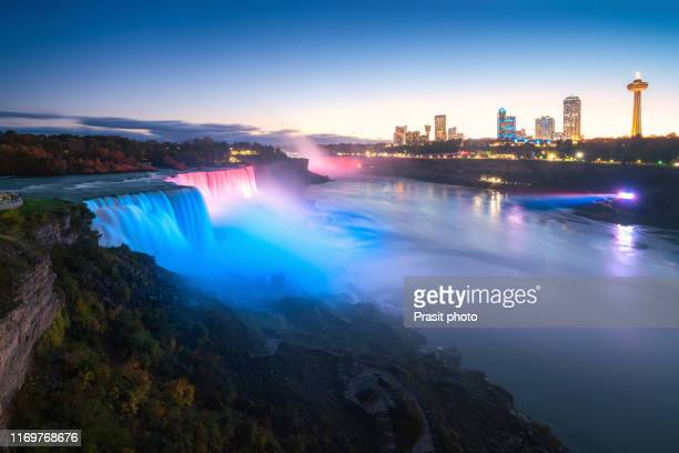 niagara falls waterfall and colorful sky at night in new york, usa. - ナイアガラ滝 ストックフォトと画像