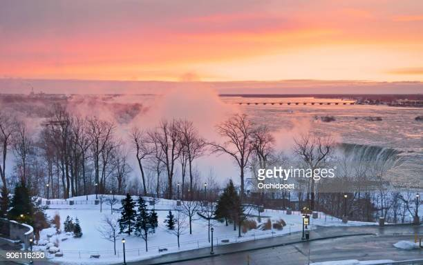 niagara falls winter sunrise - niagara falls stock pictures, royalty-free photos & images