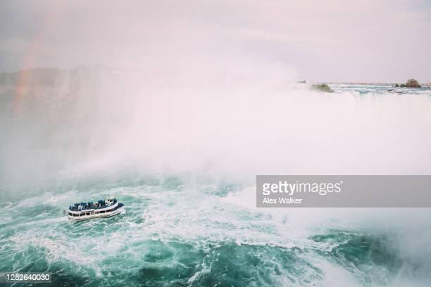 niagara falls with tour boat - niagara falls photos stock pictures, royalty-free photos & images
