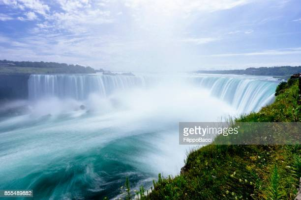 niagara horseshoe falls from aerial point of view - long exposure - niagara falls stock pictures, royalty-free photos & images