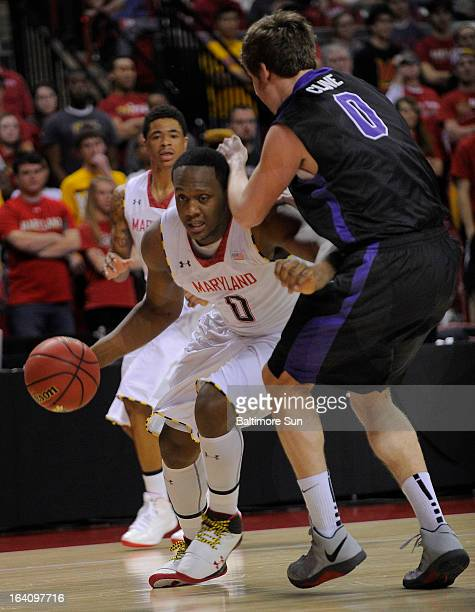 Niagara's TJ Kline guards Maryland's Charles Mitchell during firsthalf action in the NIT Tournament at the Comcast Center in College Park Maryland...