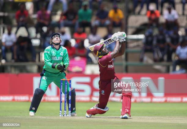 Nial O' Brien of Ireland looks on as Rovman Powell of The West Indies scores runs during The ICC Cricket World Cup Qualifier between The West Indies...