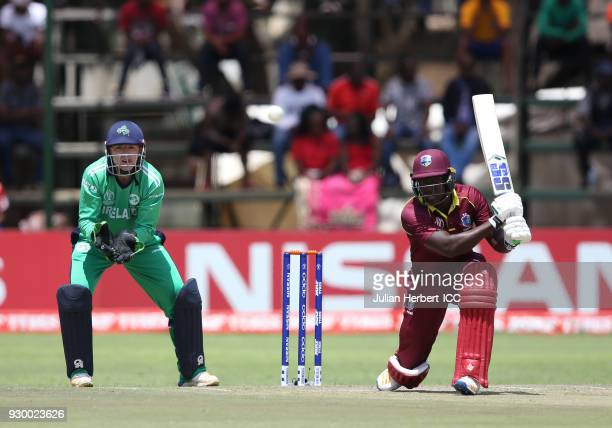 Nial Oâ Brien of Ireland looks on as Rovman Powell of The West Indies hits out during The ICC Cricket World Cup Qualifier between The West Indies and...
