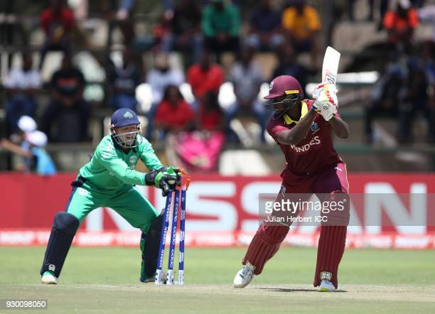 Nial O'Brien attempts to take the wicket of Jason Holder of The West Indies during The ICC Cricket World Cup Qualifier between The West Indies and...